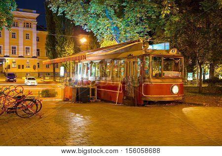 KIEV UKRAINE - SEPTEMBER 11 2016: The old tram in Taras Shevchenko park serves as the outdoor cafe on September 11 in Kiev.