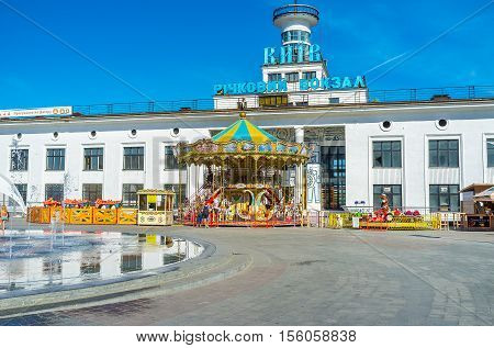 KIEV UKRAINE - SEPTEMBER 8 2016: The colorful carousel in front of River Port in Postal (Poshtova) Square in Podol district on September 8 in Kiev.