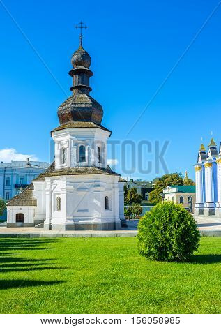 The Refectory of St John the Divine in St Michael's Golden-Domed Monastery is the medieval white building with roof of wood shingles Kiev Ukraine.