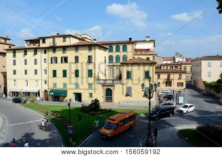 Lucca Italy - September 5 2016: Street and buildings in old part of Lucca city in Italy. Unidentified people visible.