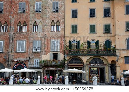 Lucca Italy - September 5 2016: Buildings on Piazza San Michele square in old part of Lucca city in Italy. Unidentified people visible.