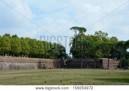 Lucca Italy - September 5 2016: Defensive walls in old Lucca city in Italy. Unidentified people visible.