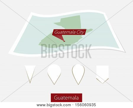 Curved Paper Map Of Guatemala With Capital Guatemala City On Gray Background. Four Different Map Pin