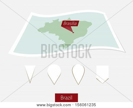 Curved Paper Map Of Brazil With Capital Brasilia On Gray Background. Four Different Map Pin Set.