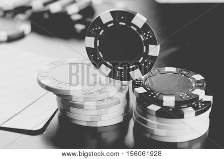 Poker chips on a wooden table in a game of Texas Hold'em Poker