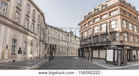 Cobblestone street in Prague and medieval buildings - Architectural image in Prague city the capital of Czech Republic with medieval buildings on the side of a cobblestone street