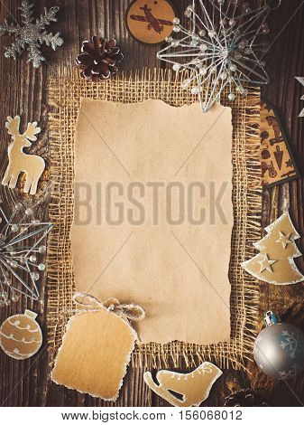 blank sheet for New Year's greetings decorations and pine cones