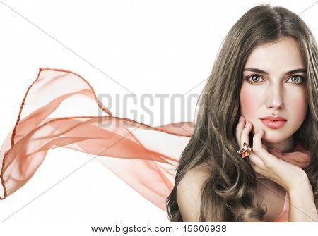 Beautiful woman in salmon color scarf on white