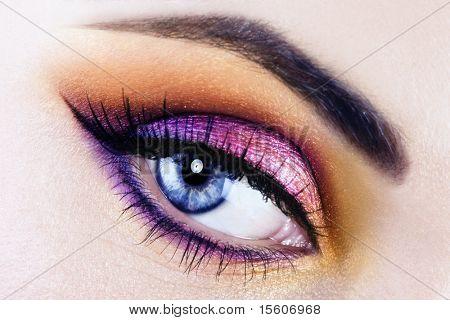 Woman beautiful eye with bright makeup