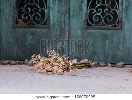 Dried Flowers At Tomb with copper patina door