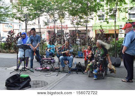 KUALA LUMPUR, MALAYSIA - DECEMBER 31, 2015 - Unidentified malaysian band playing music on the street