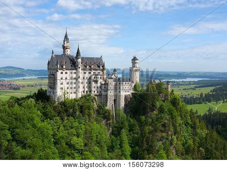 Neuschwanstein Castle on the top of the mountain Fairytale castle in Bavaria. Beautiful morning light