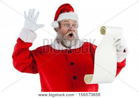 Santa claus making facial expression while reading scroll against white background