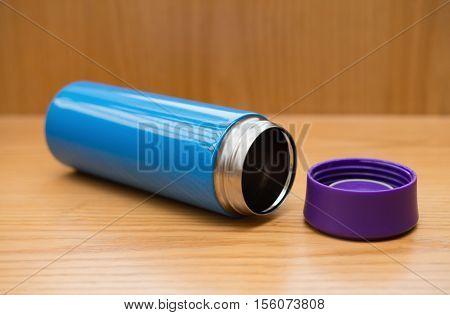 blue vacuum tumbler on a wood table