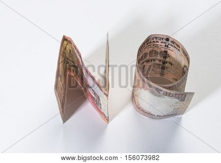 Word 'NO' formed with rolled Indian currency notes. Old One Thousand rupee notes. An idea.