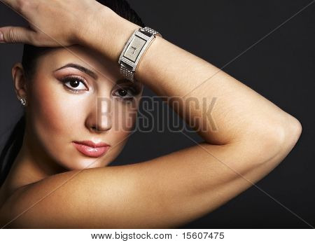 Beautiful woman with silver wristwatch