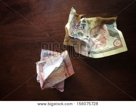 One thousand rupee and five hundred Indian rupee notes crumpled and trashed. High denomination banned by Indian Government.