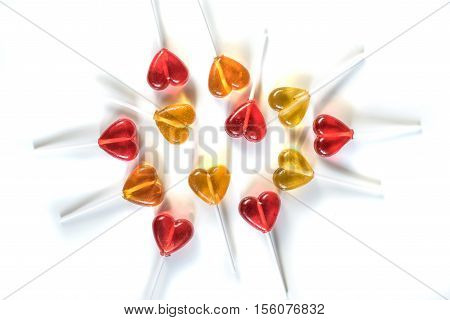 Lollipops candy sweets. Red and yellow hearts. Love concept. Valentine day. isolated on white background. abstractly placed