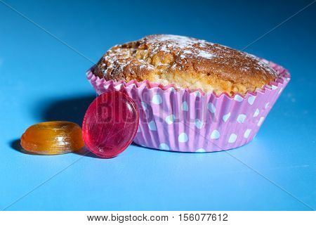muffin or cupcake on the table with and candy