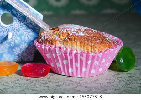muffin or cupcake on the table with bird house and candy