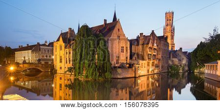 Panorama of Bruges, Belgium. Image with Rozenhoedkaai in Brugge, Dijver river canal and Belfort, Belfry, tower in twilight.