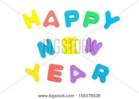words of happy new year shaped by alphabet jigsaw puzzle on white
