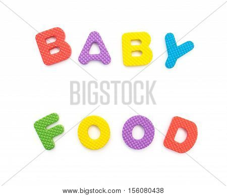 letters of baby food made by alphabet jigsaw puzzle on white