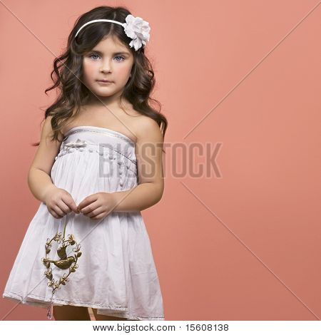Little girl with antique copper toy. Space for text.