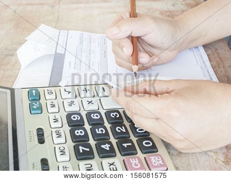 hand checking document monthly credit card expenses accounting