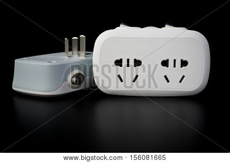 two white power sockets with switiches on black background