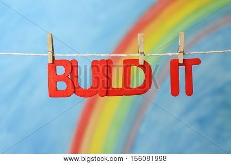 Red letters spelling the words build it grow to illustrate the concept of start up business, growth and development.