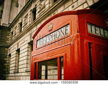 filtered image of a traditinal red London telephone call box, phone booth