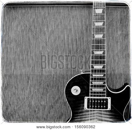 detail close up of a guitar leaning against an amplifier cabinet on stage at a concert - vintage black and white