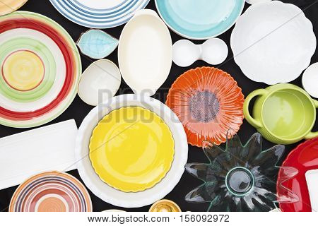 Various olorful dishes on a black background