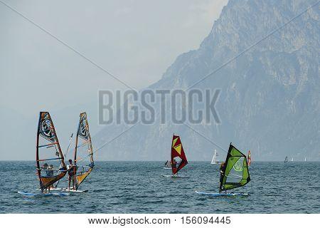 Torbole - Nago, Lago di Garda (Lago Benaco), Italy - August 11, 2015: A windsurfing on Lake Garda in Torbole resort.