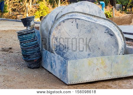 salvers and buckets after using in construction site horizontal photo