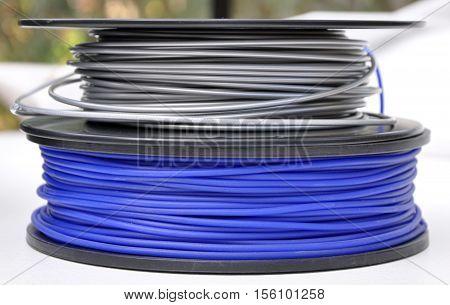 3d printing filament plastic spools, blue and silver