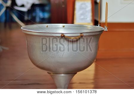 Font for the baptism of children in the Orthodox Church.