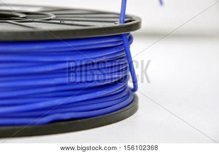 Blue 3d printing filament spool, close up