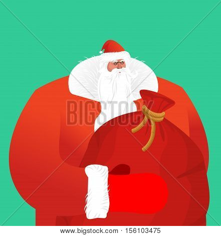 Santa Claus With Sackful Toys And Sweets. Big Red Festive Bag. Great Grandpa With White Beard And Re