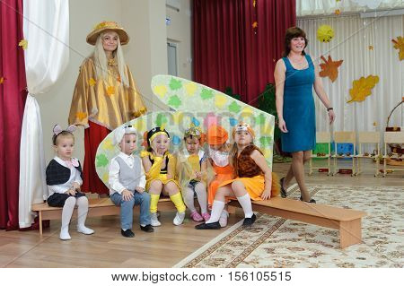 BALASHIKHA RUSSIA - OCTOBER 26: Six small children dressed in carnival costumes and two adult women taking part in autumnal matinee in kindergarten on Zarechnaya Street on October 26 2016 in Balashikha.