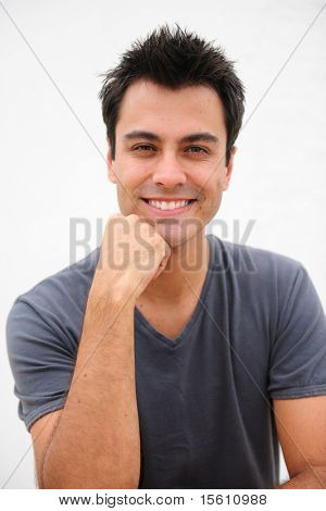portrait of a happy hispanic man smiling isolated on white