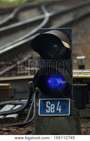 Blue train traffic light. Shunting railway semaphore with blue light, Czech Republic.