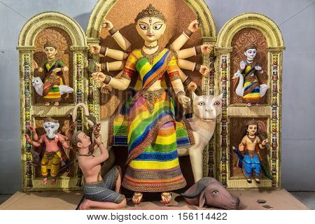 Artistic hindu goddess Durga idol created from clay. Durga is seen to fight with the evil Mahishasura signifying a win of good over evil.