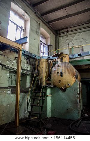 Old equipment tank alcoholmeters in in an abandoned Voronezh Distillery