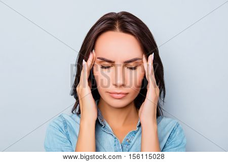 Portrait Of Sad Young Woman Saffering Of Strong Headache