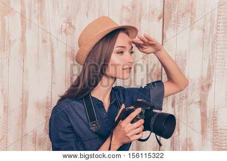 Young Pretty Woman With Camera Looking For New Cadre