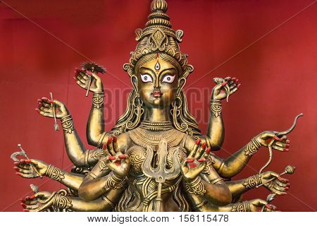 Goddess Durga idol copper finish closeup portrait. Goddess durga is worshipped by Hindus in India and abroad and depicts victory of good over evil.