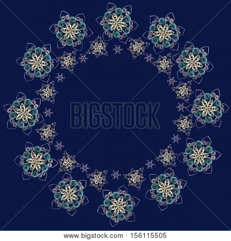 Round frame or wreath made of handmade paper snowflakes in quilling technique on dark blue background. Can be used as Christmas or New Year background for cards napkins wrapping paper.