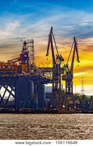 Oil rig under construction at sunset in Gdansk Poland.